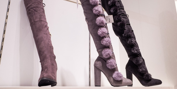 These thigh-high pompom boots are part of Ivanka's shoe collection. Photo / Getty