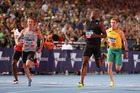 Usain Bolt crosses the finish line to win the Nitro Series 150m race ahead of New Zealand's Joseph Millar. Photo/Getty Images