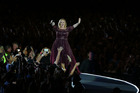 Adele walks the outer-ring of her stage. Photo / Getty Images