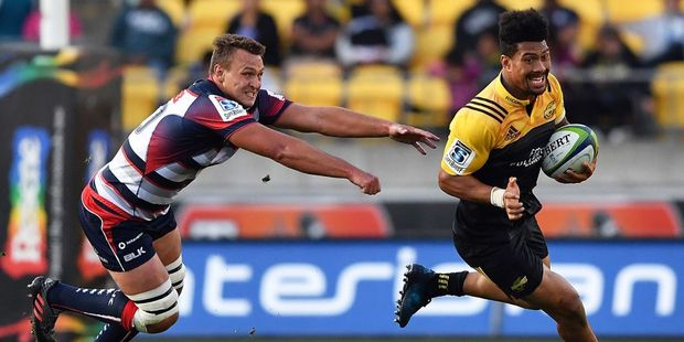 Ardie Savea on the run against the Melbourne Rebels. Photo / Getty
