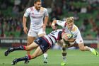 Damian McKenzie being brought down during the Chiefs' win over the Rebels. Photo / Getty