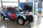Hayden Paddon, David Holder and Job Quantock pose with the Hyundai i20 AP4. Photo / Supplied