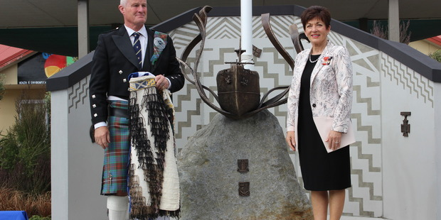 NOT FORGOTTEN: Otaki College principal Andy Fraser and Govenor-General Patsy Reddy unveil a monument.