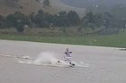 A flooded paddock brings an opportunity to go wakeboarding in a paddock in Kaukapakapa