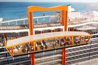Celebrity Edge's 'Magic Carpet' moves around the edge of the ship. Photo / Supplied