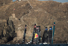 Picture of the fleet racing close to the shore and historic town of Mutrah. Photo / Extreme Sailing Series