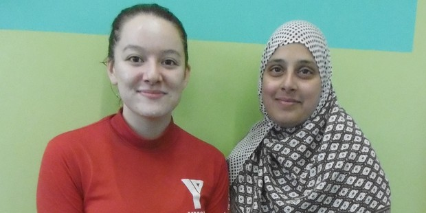 YMCA instructor Bernadine (left) with Gayas Fathima, who was afraid of the water before she started Muslim women-only swimming classes. Photo/Supplied