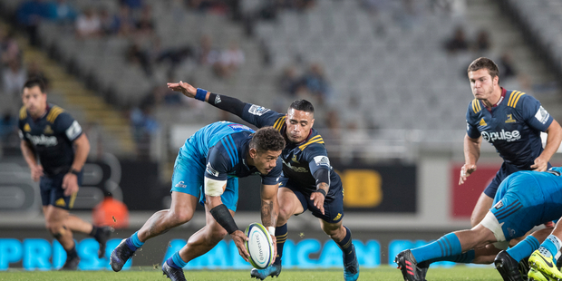 Blues halfback Augustine Pulu fights for loose scrum ball during a game at Eden Park. Photo / Greg Bowker