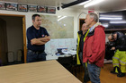 Phil Goff talks with Civil Defence in Clevedon as heavy rain fell in Auckland over the weekend. Photo / Dean Purcell