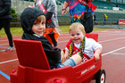 Micah, 4, and Jethro Chiet get a tow around Cooks Gardens in the Cancer Society's Relay for Life. PHOTO/ BEVAN CONLEY