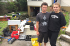 Dillon Craven, left, and his partner Sophie Matthews. The basement garage of their rented Barnfield Pl, Glendene, home was flooded during this morning's deluge. Photo / Cherie Howie