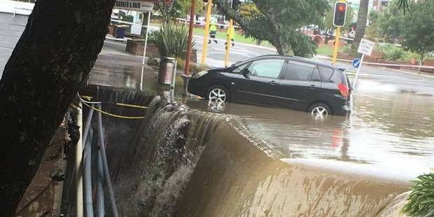 Loading A giant sinkhole has opened up in a New Lynn street after yesterday's flash flood.  Photo / via Facebook