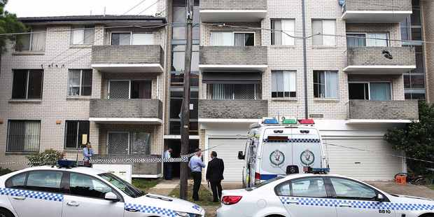 Police crime scene at 11 Grace Campbell Crescent Sydney, where Kiwi woman Stacey Docherty and her son four year old son Seth were found dead inside. Photo / Daily Telegraph
