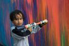 Kennedi Wharerahi-Rehu, 3, paints the wall. Photo/Supplied