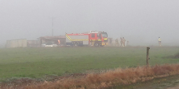Loading Fire crews at the scene of a fatal house fire on SH5 at Rangitaiki.