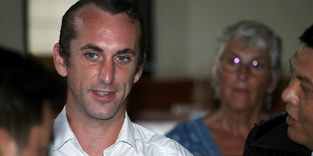 British national David Taylor, left, talks to his lawyers before his trial in Bali. Photo / AP