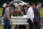 Pallbearers carry the casket of 6-year-old Jeremy Mardis to a grave site at Beaumont Cemetery in Beaumont on November 9, 2015. Photo / AP