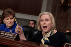Senate Armed Services Committee member Senator Kirsten Gillibrand right, joined by Senator Jeanne Shaheen, questions Marine Corps Commandant General Robert B Neller. Photo / AP