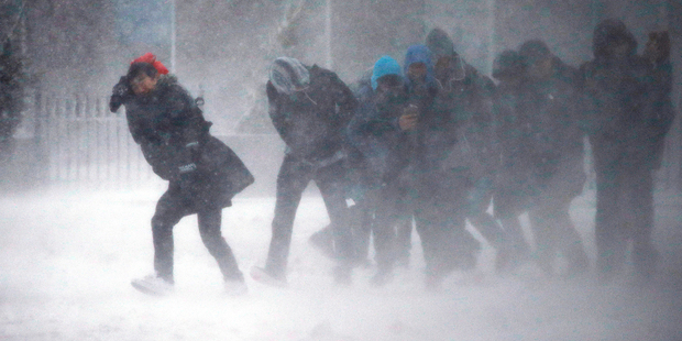 People struggle to walk in the blowing snow in Boston. Photo / AP