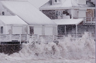 Waves from the Atlantic Ocean pound into the seawall near high tide during a winter storm in Massachusetts. Photo / AP