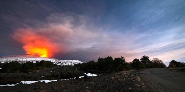 Mount Etna, Europe's most active volcano, is seen from the side of a road as it spews lava during an eruption in the early hours of March 16, 2017. Photo / AP