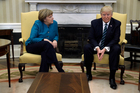 President Donald Trump refused to shake hands with German Chancellor Angela Merkel in the Oval Office of the White House. Photo / AP