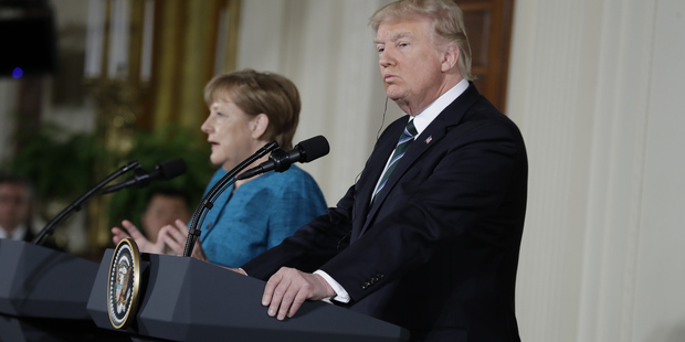 President Donald Trump and German Chancellor Angela Merkel participate in a joint news conference. Photo / AP