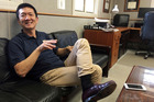 Hawaii Attorney General Douglas Chin sits in his office in Honolulu. Photo / AP