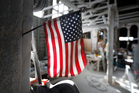 The American flag hangs in the production area of a Marble plant in Iowa. Photo / AP