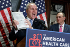 House Majority Whip Steve Scalise, left, joined by Rep. Phil Roe, holds up a copy of the original Affordable Care Act bill during a news conference on Capitol Hill in Washington. Photo / AP