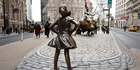 The Fearless Girl statue apeared opposite Wall Street's bull in time for International Women's Day. Photo / AP
