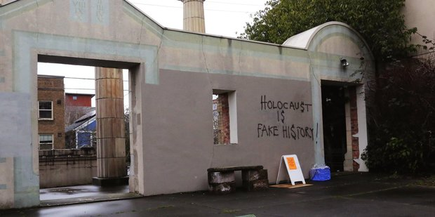Loading Anti-Semitic Holocaust-denying graffiti is seen on the facade of Temple De Hirsch Sinai in Seattle. Photo / AP