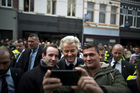 Firebrand anti-Islam lawmaker Geert Wilders, poses for a selfie with supporters during a campaign stop in Heerlen, Netherlands. Photo / AP