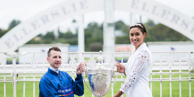 Silver Fern Maria Tutaia and jockey Leith Innes holding the Auckland Cup.