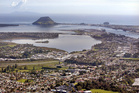MARKET SWING: The median value of homes sold in Tauranga has dropped, but Mt Maunganui is up and down. PHOTO / FILE