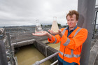 Watercare's James Talbot compares treated water with untreated water from the Hunua dams. Photo / NZME