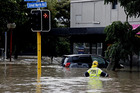 Fire crews assist as a massive amount of rain caused flooding in New Lynn, Auckland on March 12. Photo / Dean Purcell