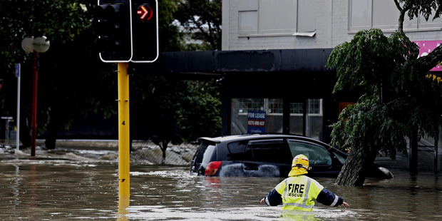 Loading Fire crews assist as a massive amount of rain caused flooding in New Lynn, Auckland on March 12. Photo / Dean Purcell