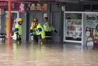 Fire crews assist as a massive amount of rain caused flooding in the town centre of New Lynn, Auckland. 12 March 2017 New Zealand Herald Photograph by Dean Purcell. NZH 14Mar17 - Floods in New Lyn
