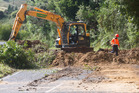 Contractors clear away debris blocking Paradise Valley Rd.  Photo/Stephen Parker