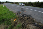 Waitangi, south of Te Puke could be in for slower traffic as the council proposes changing the speed limit from 70km/h to 50km/h. Flowers (pictured) mark the scene of a fatal crash seven years ago.