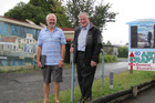 Katikati Councillor Mike Williams and Mayor Garry Webber stand at where an entry pathway is expected to lead to a new community facility. Photo/file