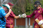 Taradale batsmen Jason Trembath (left) and Josh Jones touch gloves as a contemplative Cornwall skipper Jacob Smith grabs the rim of his hat. Photo/Warren Buckland