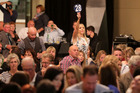 Michelle Hawkins from Taradale bids at the Property Brokers Relay for Life Charity Auction last night. Photo/Duncan Brown