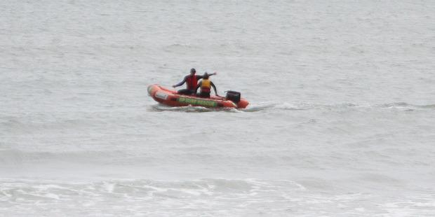 A Far North Surf Rescue IRB searching at Ahipara.