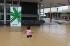 Not everyone was bothered by the flooding in Dargaville - this girl was making the most of it. Photo/Rose Stirling
