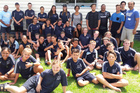 Nigel Vagana (back right, light blue) and Nicky Wright (back left) accompanied by RLN Benson Selwyn (back wall, Pirtek shirt) during their visit to Abundant Life School earlier this month.