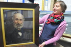 CHB Settlers Museum curator and manager Jana Uhlirova with the portrait of Henry Russell.