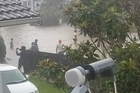 Homes have been flooded in Auckland, with some in waist-deep water.