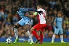 Manchester City's Yaya Toure, left, holds off Monaco's Radamel Falcao. Photo / AP